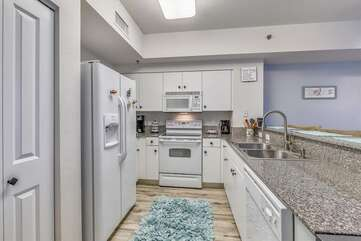 Kitchen with granite counter tops and large fridge/freezer