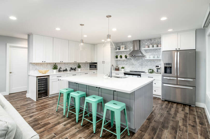 Fully upgraded, modern kitchen with beverage fridge, high-end stove top and more.