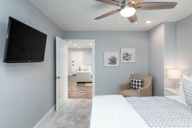 Two bedrooms with televisions.