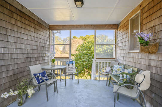 Shady spot on the porch - great for and afternoon cup of tea! 67 The Cornfield Chatham Cape Cod - New England Vacation Rentals