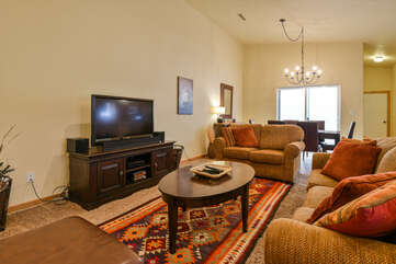 Living room with a flatscreen TV and two couches