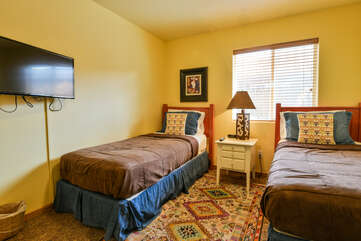 Bedroom with two twin beds and a nightstand