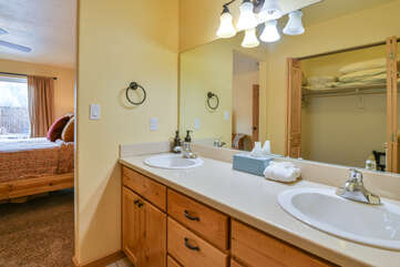 Master bathroom with two sinks and a large mirror