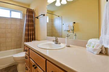 Bathroom with a bathtub and one sink