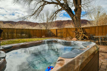 Private back yard and hot tub with seating