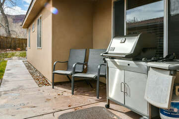 Patio and private grill with two chairs