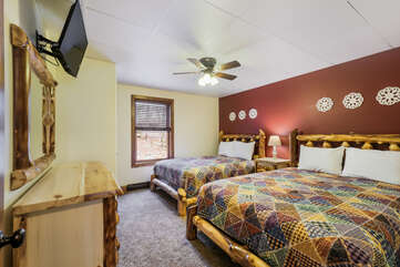 Bedroom with Two Beds, Ceiling Fan and Mounted TV