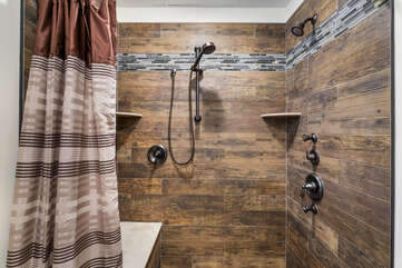 Walk-In Shower with Multiple Shower Heads and Bench