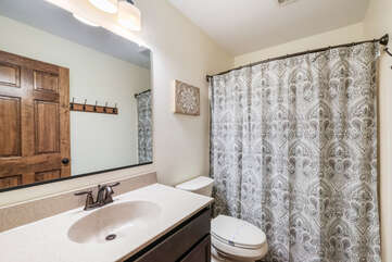 Bathroom with Toilet, Sink, and Shower with Curtain