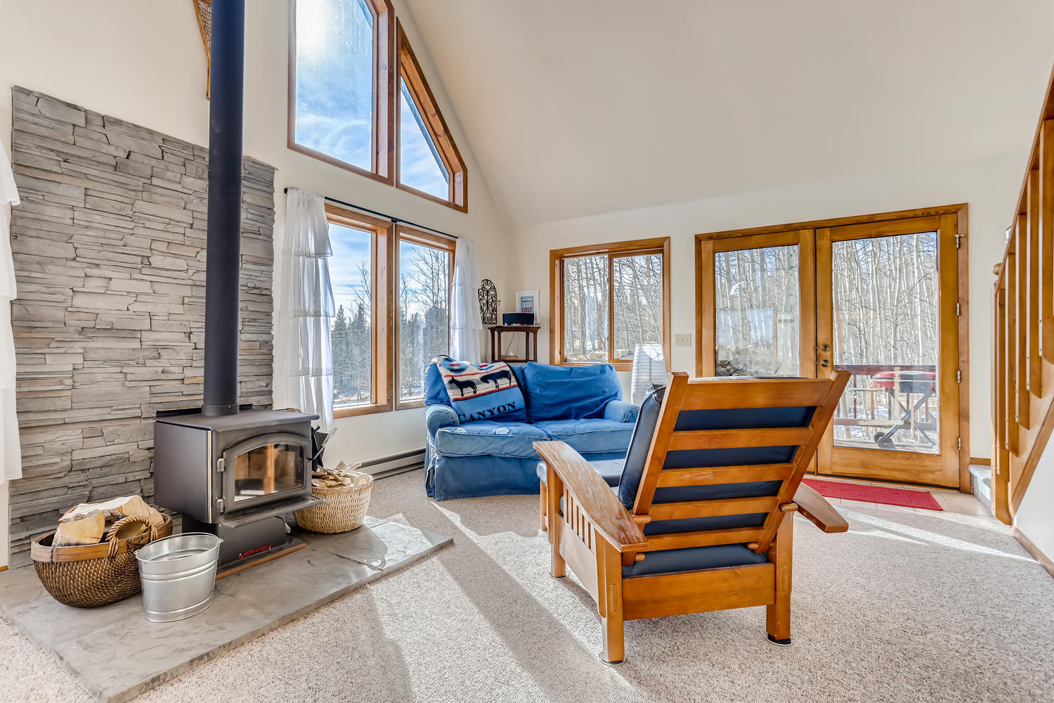 Cozy wood stove and a lounging area is one of two family areas.