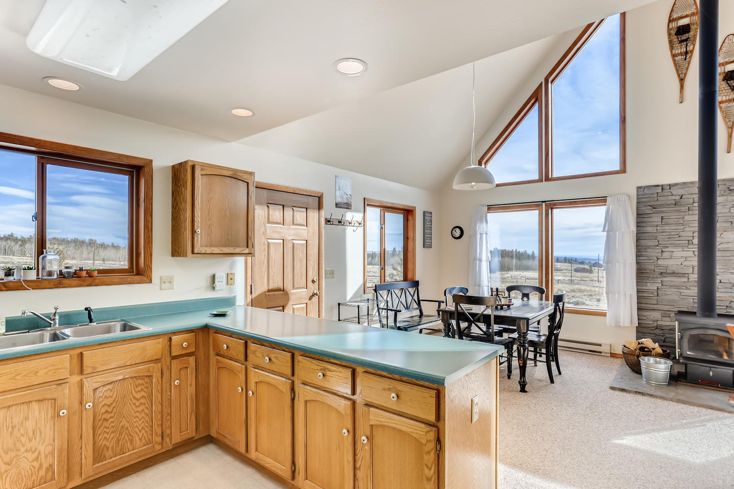 Kitchen has everything needed to make meals, plus a view.
