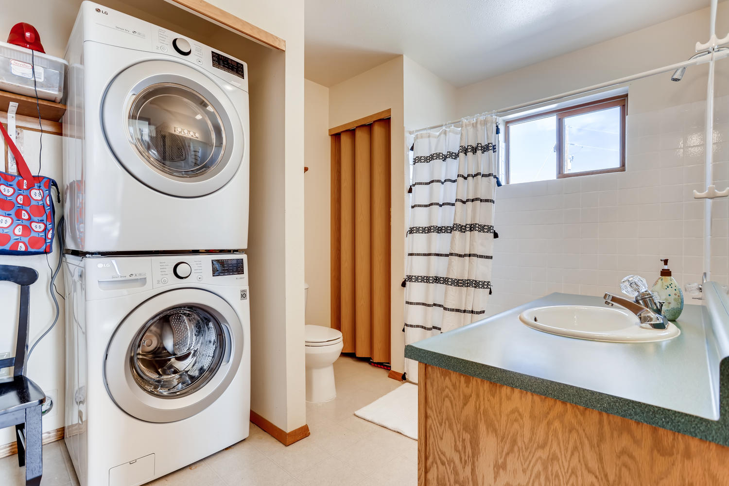 The bathroom has new washer and dryer along with a shower/tub combination.