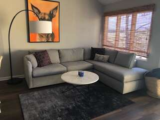 Fabulous views from bright, open living area with vaulted ceiling and beautiful, comfortable sectional sofa