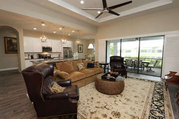 Living room with lanai access and lake view