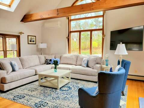 Large living room windows to let in the natural light.  335 Meeting House Rd- Chatham- New England Vacation Rentals
