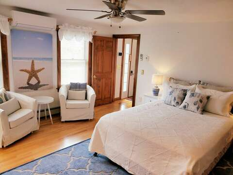 Bedroom #1 with fan and coast decor.   335 Meeting House Rd- Chatham- New England Vacation Rentals