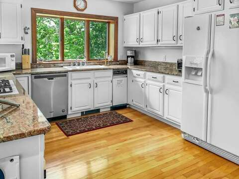 Recently refreshed Full kitchen with open concept dining, breakfast bar.  335 Meeting House Rd- Chatham- New England Vacation Rentals