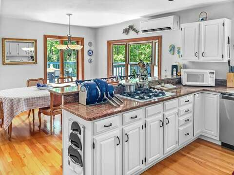 Open concept dining and kitchen. 335 Meeting House Rd- Chatham- New England Vacation Rentals