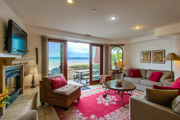 Living Room with a Bayfront View & Access to Patio