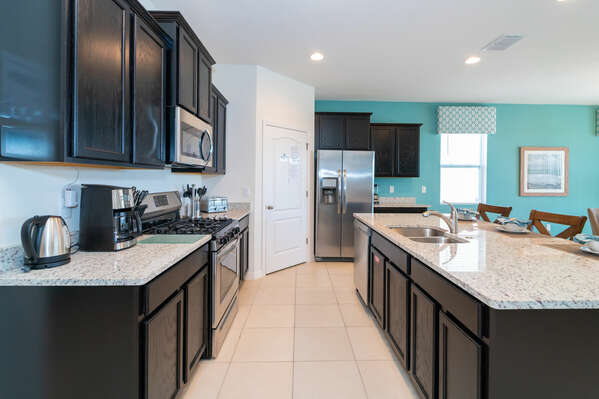 Kitchen has stainless appliances and gas cooktop