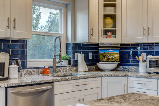 Remodeled Kitchen with Granite Counters and Shaker Cabinets