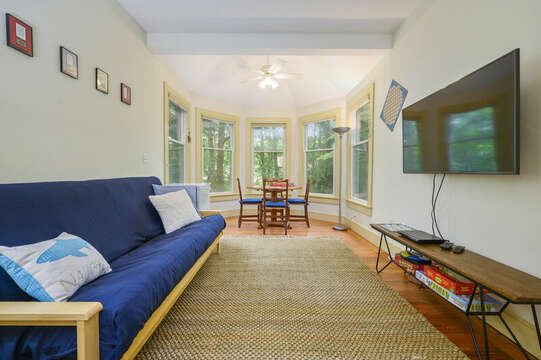 Family/game room Main Floor with Futon and Flat Screen TV - 9 Reliance Way Harwich Cape Cod - New England Vacation Rentals