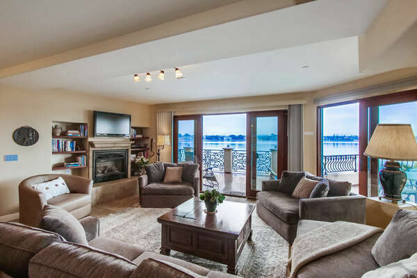 Living Room with Bay Views, Fireplace and TV in our Vacation Rental in San Diego