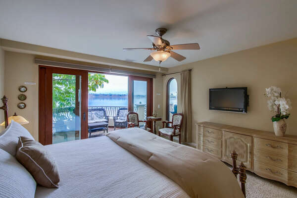 Master Bedroom with a King Bed, En Suite Bathroom, TV, and Deck Access