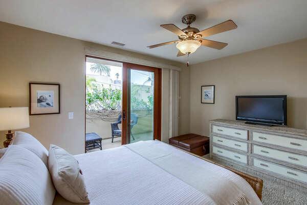 Guest Bedroom - Queen Bed, TV and Balcony