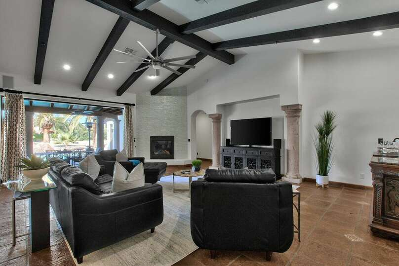 Living Room with Flat Screen TV and Leather Couches at our Vacation Rental in Scottsdale Arizona