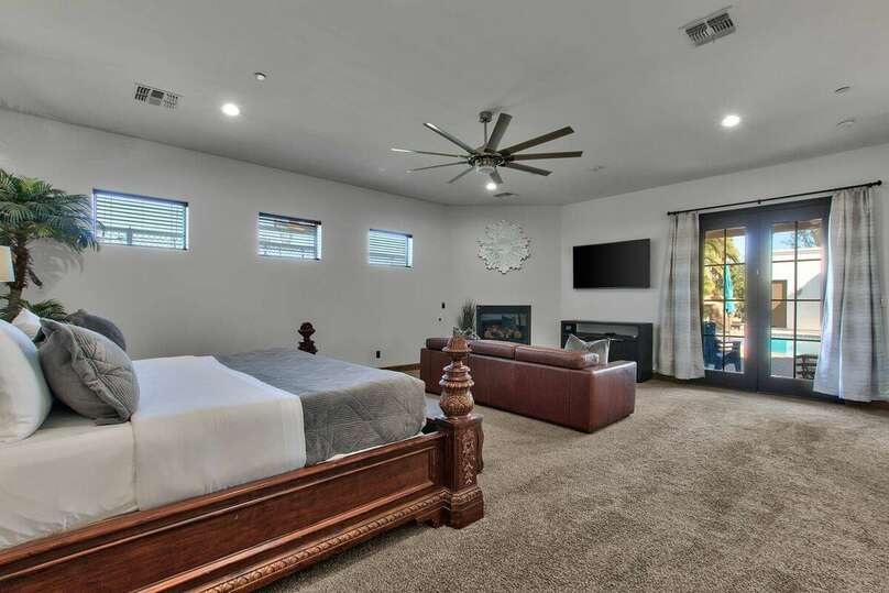 Bedroom with Couch, Flat Screen TV, and Bed in our Vacation Rental in Scottsdale Arizona