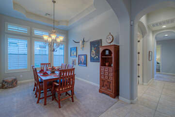Formal dining area with trey ceiling is lovely setting for entertaining and impressing your guests