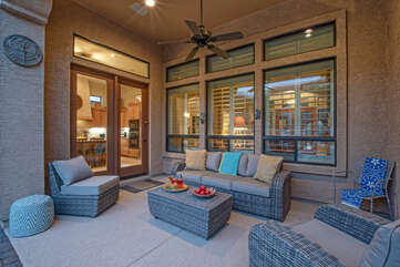 Covered porch is chic and comfortable