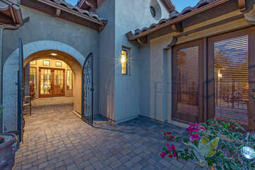 Welcome to the gated entrance of our one story luxury home in  a most peaceful and appealing setting