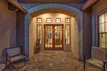 Home's elegant front entrance hints at the splendor that lies within