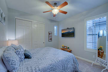 Third bedroom has a king bed, TV, ceiling fan and window views