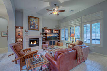 Lovely great room embodies the rich southwestern decor found throughout home