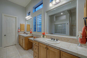 Primary bath includes dual vanities with sinks and mirrors