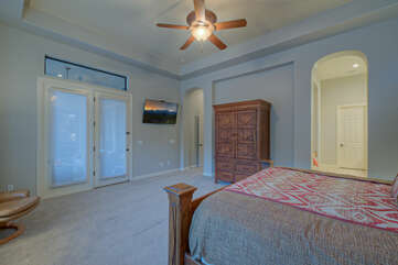 Door in primary suite accesses the backyard paradise for romantic escapes to the spa or pool
