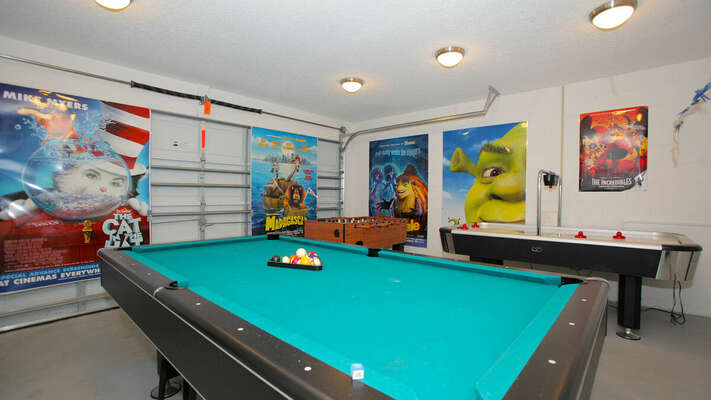 Garage converted to a games room and has pool table, air hockey and foosball.