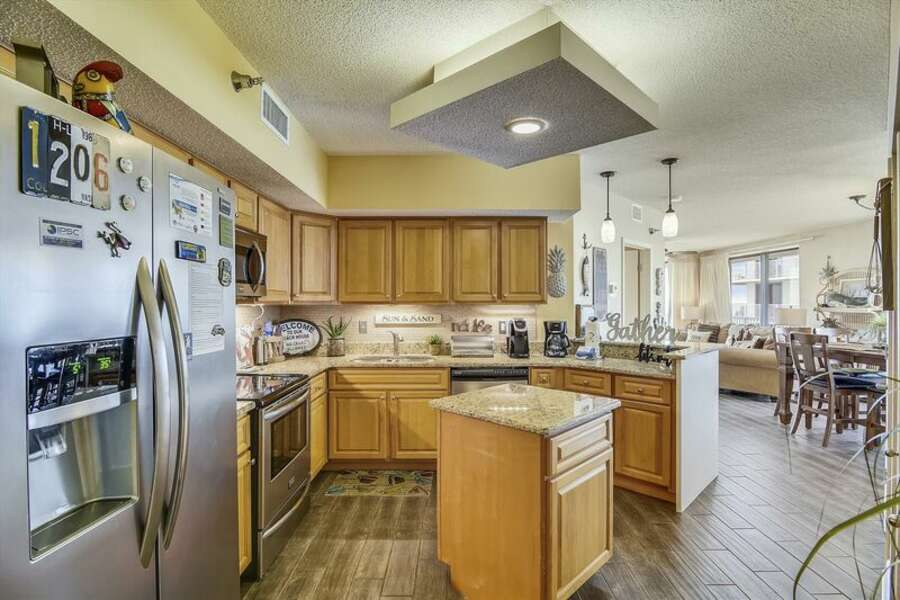 Updated Kitchen with Stainless Steel Appliances, Granite Counter Tops and a Breakfast Bar