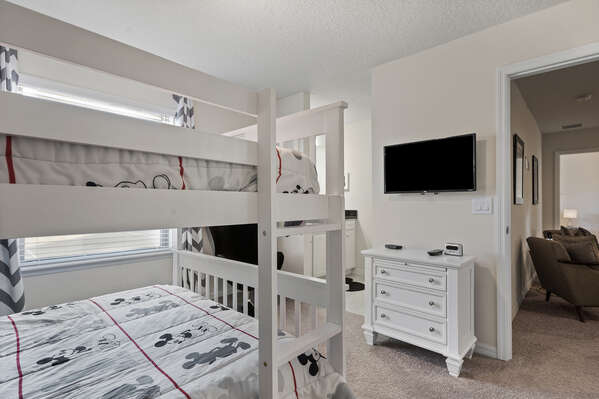 Featuring a full over full bunk bed and TV
