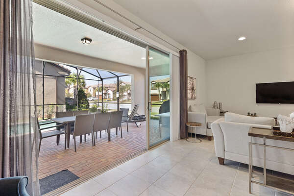 Slide open the large glass doors to your own private lanai