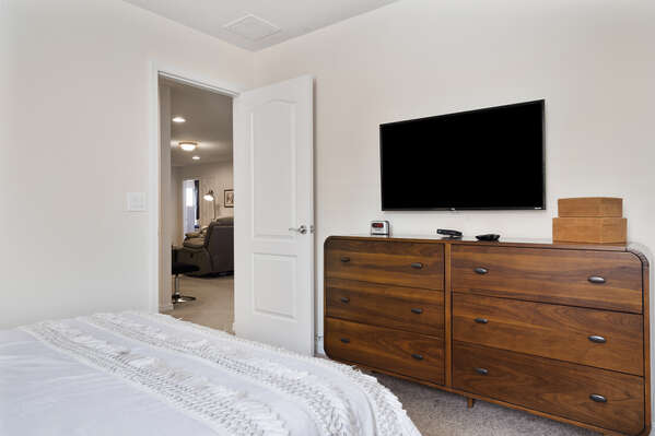 Featuring a TV and large dressers for plenty of storage space