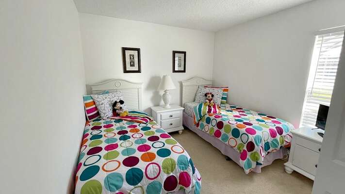 Bedroom 3 has twin beds, double closet and flat screen TV