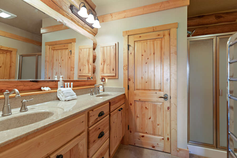 Leaky Waders ~ main house main level master bedroom w/ king bed and ensuite bathroom w/ shower
