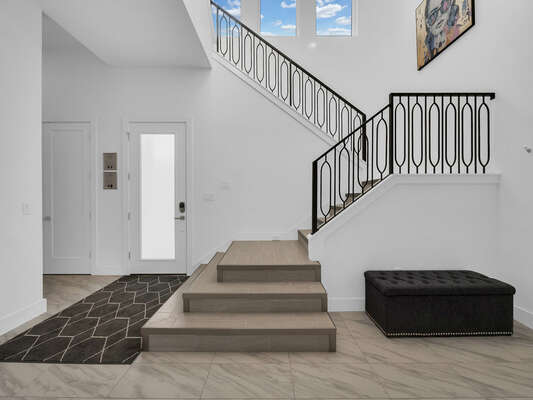 The stairs are located right by the entrance of the home