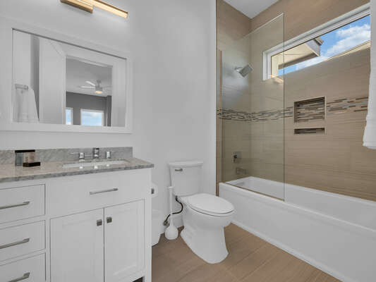 This bathroom has a combination shower and tub