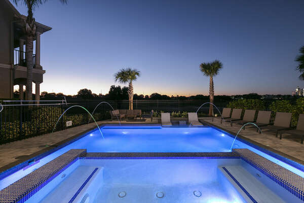 Exterior lighting illuminates the pool for the perfect twilight experience