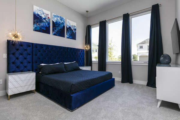 After a day of fun, retreat to this bedroom with a king size bed